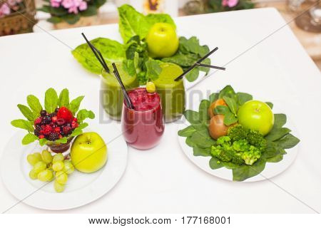 Healthy green and red smoothies and ingredients - superfoods detox diet health vegetarian food concept