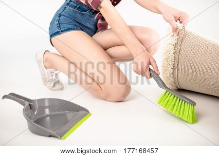 Woman With Scoop And Brush