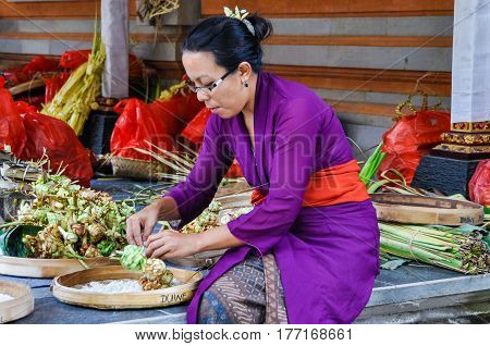 BALI, INDONESIA - SEPTEMBER 27, 2012: Balinese woman in the Tirta Empul Temple in Bali Indonesia