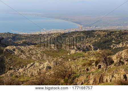 Adriatic coast: the Gulf of Manfredonia.ITALY (Apulia). Gargano promontory: panoramic view from Monte Sant'Angelo. Rural landscape with trullo and pasture.