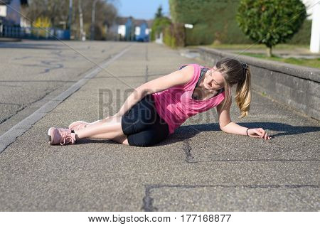 Female Athlete With Calf Cramps
