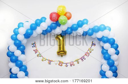 First birthday anniversaey decoration on white wall - Number 1 in golden color