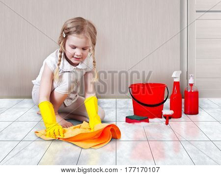 Little girl helps with the cleaning in the house. You wash the floors