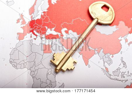 Gold color key on the world map horizontal photo