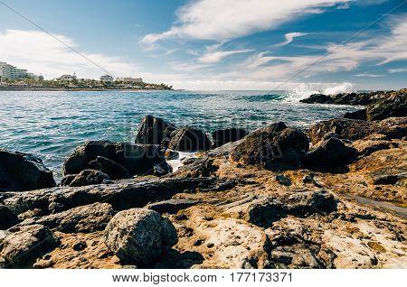 Wonderful view on rocky coastline of Costa Adeje resort by sunny day Tenerife Spain