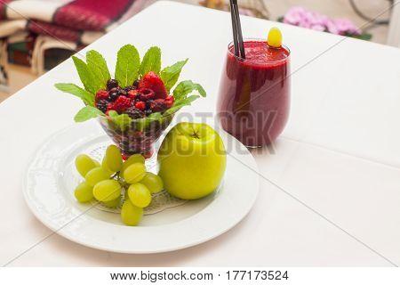 Healthy red smoothie and ingredients - superfoods detox diet health vegetarian food concept