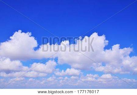 The vast blue sky with white clouds