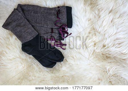 Brown knee socks on the white fur