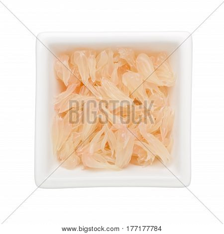 Shredded pomelo flesh in a square bowl isolated on white background