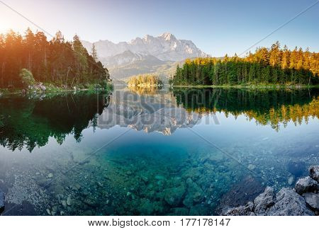 An impressive view of the famous lake Eibsee. Wonderful day gorgeous scene. Location resort Garmisch-Partenkirchen Bavarian alp, Europe. Climate change. Popular tourist attraction. World of beauty.