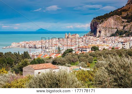 An impressive view of the famous resort Cefalu. Location place Sicilia, Italy, Piazza del Duomo, Tyrrhenian sea, Europe. Wonderful day and gorgeous scene. Popular tourist attraction. World of beauty.