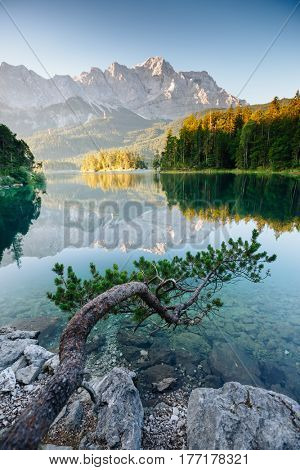 A look at the famous lake Eibsee in sunligth. Wonderful day gorgeous scene. Location resort Garmisch-Partenkirchen Bavarian alp, sightseeing Europe. Best place on earth. Explore the world's beauty.