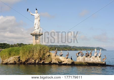 Livingston, Guatemala - 20 January 2014: Statue of Salvador del mundo on the coast of Livingston on Guatemala