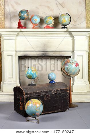 Old Battered Chest Or Trunk With Vintage Globes