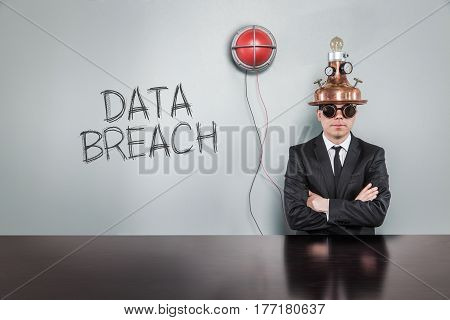 Data breach text with vintage businessman and alert light