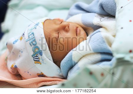 New born Baby sleeping in the bed