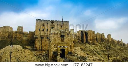 Entrance to Aleppo citadel damaged by ISIS now Syria