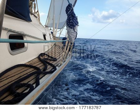 Yacht sailing on the sea side view, waves,  mobile stock