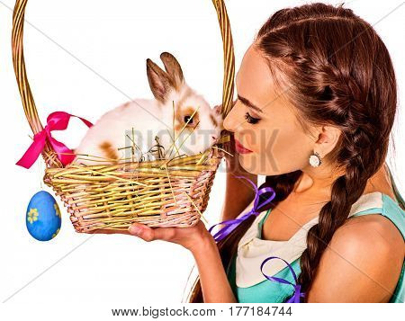 Easter dresses for women. Girl holding bunny and eggs. Woman with two holiday long braids and make up holding white rabbit in basket with flowers. Adults at festival. White background isolated.