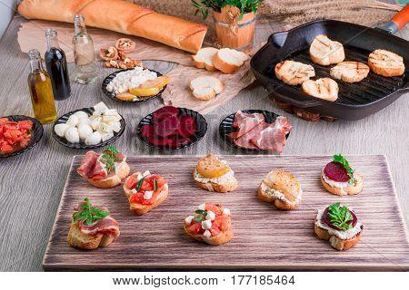 Set Of Bruschetta On Wooden Board. Ingredient For Crostini. Italian Food.