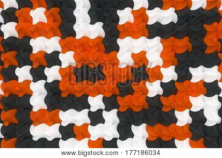 Pattern Of Black, White And Orange Twisted Pyramid Shapes