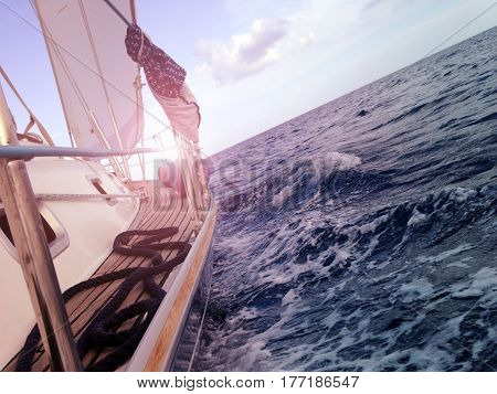 Yacht sailing on the sea, side view, waves, mobile stock