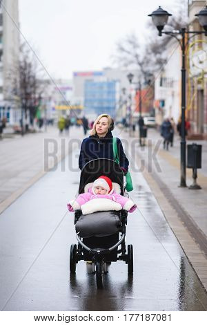 Mom And Baby Are Walking In The City