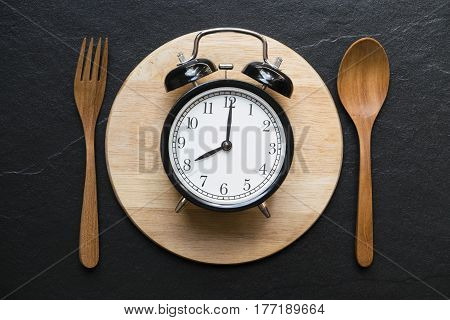 Meal time with alarm clock at breakfast time