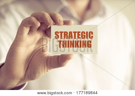 Businessman Holding Strategic Thinking Message Card