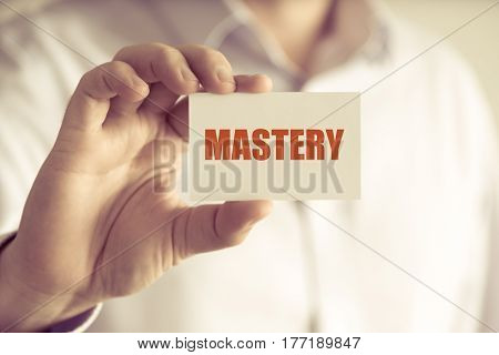 Businessman Holding Mastery Message Card