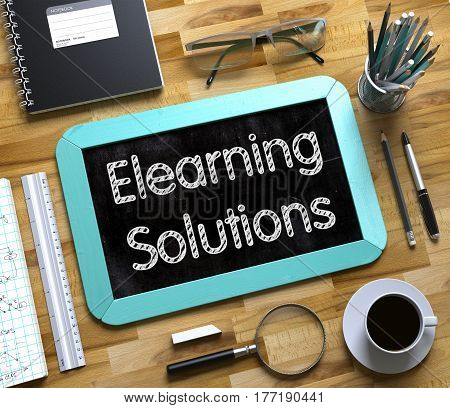 Elearning Solutions on Small Chalkboard. Elearning Solutions Handwritten on Mint Chalkboard. Top View Composition with Small Chalkboard on Working Table with Office Supplies Around. 3d Rendering.