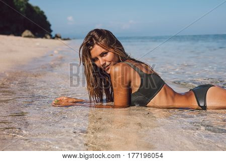 Beautiful Bikini Model Relaxing On The Beach