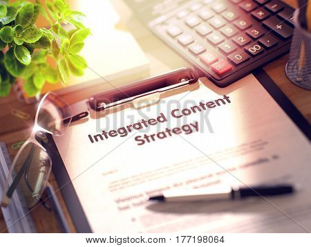 Integrated Content Strategy on Clipboard with Paper Sheet on Table with Office Supplies Around. 3d Rendering. Blurred and Toned Illustration.