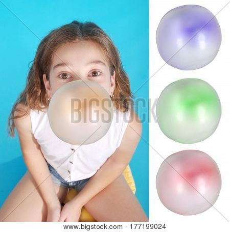 Top view of beautiful young brunette girl blowing bubble gum isolated on blue. Many varieties of gum color for your Projects