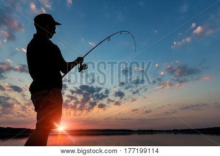 fishing rod lake fisherman men sport summer lure sunset