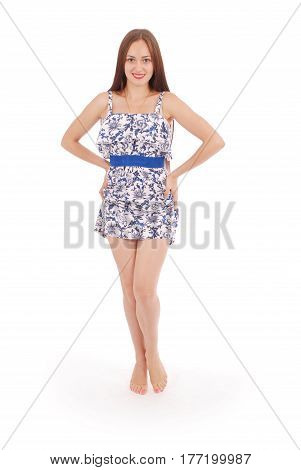 Full body portrait of young woman in dress. White background.