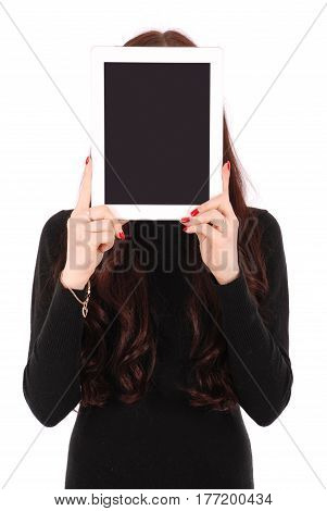 Girl keeps tablet pc the face isolated on white