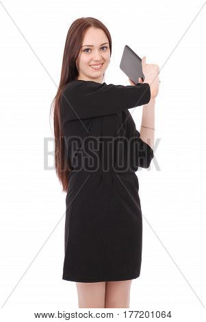 Girl in movement holds tablet computer isolated on white