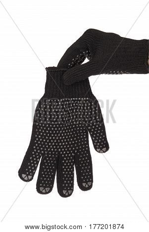Gardener hand in resistance glove which holds the other glove isolated on white background