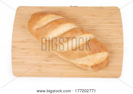 Loaf fresh bread on wooden board for cutting isolated on white background. Clipping path