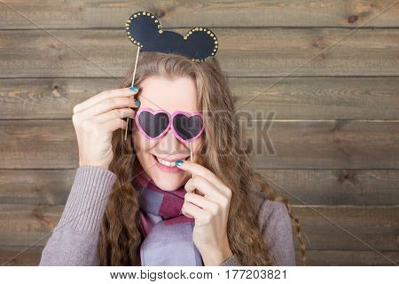 Cute girl with hairstyle and sunglasses on sticks