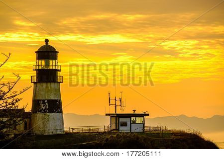 Cape Disappointment Lighthouse at sunrise, built in 1856, Pacific coast, WA, USA