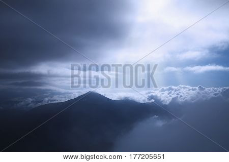 Picturesque view of the mountains that glow under sunlight. Dramatic evening scene. Location place Carpathian Mountains the highest mountain of Ukraine - Hoverla. Artistic picture. Beauty world.