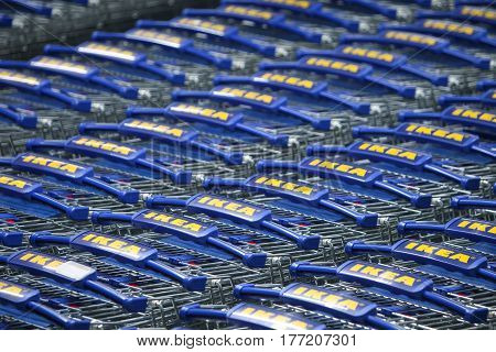 ZAGREB CROATIA - FEBRUARY 23 : A large group of IKEA shopping carts lined up in rows in trolleys area of IKEA Zagreb store on February 23rd 2015 in Zagreb Croatia. Founded in Sweden in 1943 Ikea is the world's largest furniture retailer.