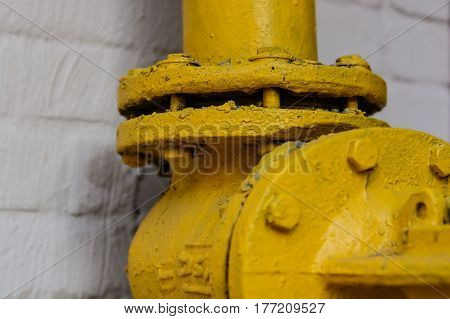 Close up of yellow gate valve connection