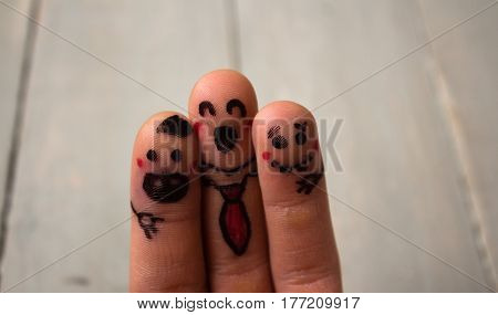 a happy singing fingers on wooden background