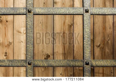 The background wrought-iron fence with wooden planks