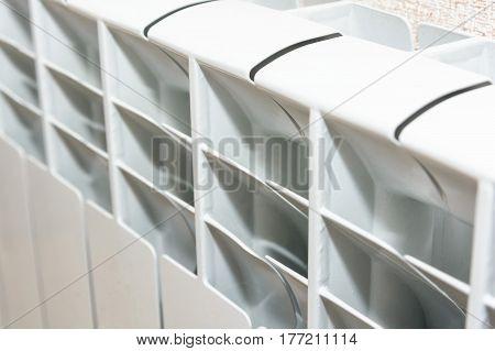 Close-up of modern hot water baseboard radiator