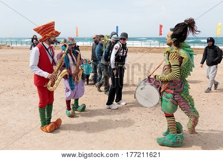 Participants Of Festival Dressed As Clowns Playing Musical Instruments