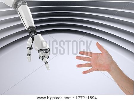 Digital composite of robot hand helping human hand against modern background
